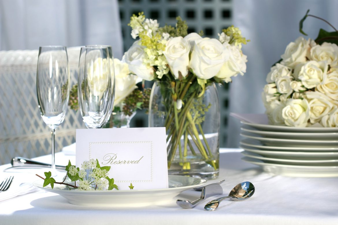White place card on outdoor wedding table with flowers